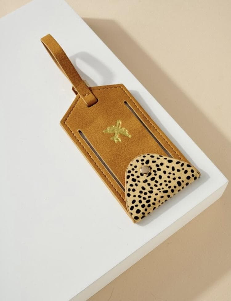 Enter to win a Cheetah Print Luggage Tag from Scout and Poppy. Giveaway Image
